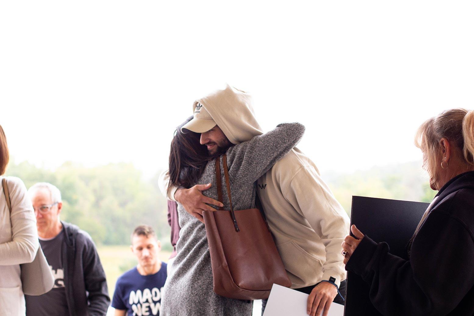 hugs enter new church