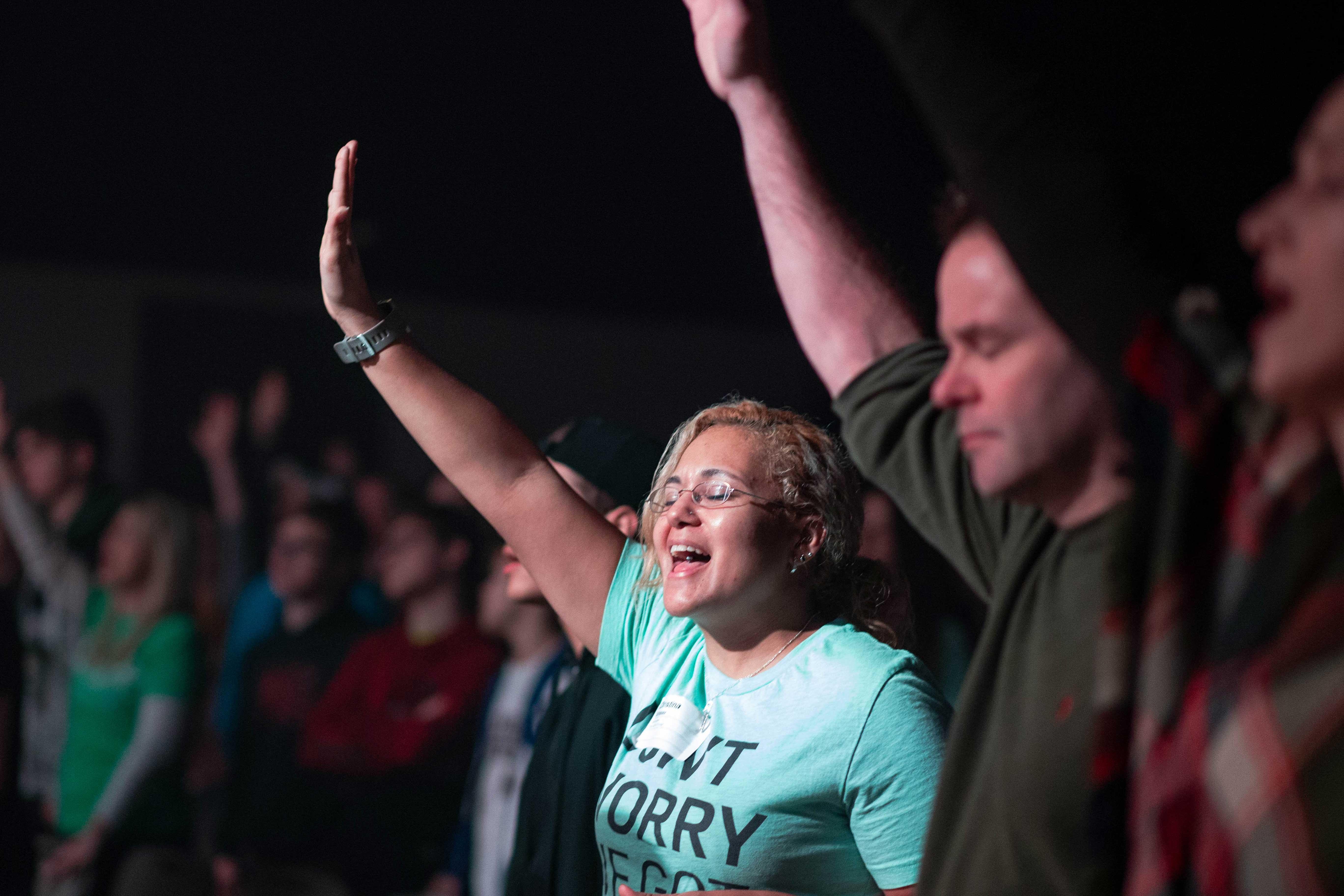 worship raising hands